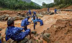 Kerala Flood:Rescue workers search for the bodies of missing persons after a landslide, triggered by- IndiaTV Paisa