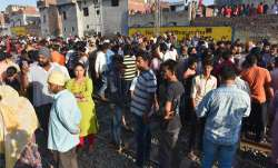 local people gather at the scene of the...- India TV Paisa