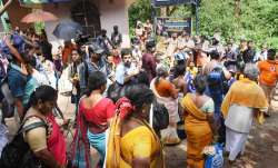 Devotees, including women, outside the Lord Ayyappa...- India TV Paisa