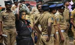 An elderly woman on her way to Sabarimala Temple...- India TV Paisa