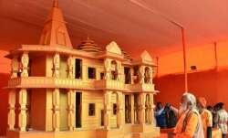 <p>People look at a model of...- India TV Paisa