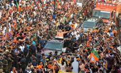 Prime Minister Narendra Modi during his roadshow, a day ahead of filing his nomination papers- India TV Paisa