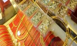 Gold slides by Rs 160 on muted demand, weak global trend- India TV Paisa