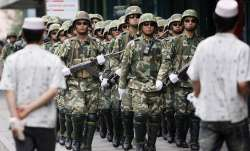 China defends Xinjiang detention centres for Uighurs, invites Bachelet | AP File- India TV Paisa