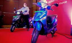 Hero Electric India CEO Sohinder Gill poses with a newly launched electric two-wheeler- India TV Paisa