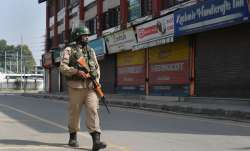 <p>A security personnel...- India TV Paisa