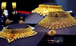 Gold gains Rs 145 on weaker rupee- India TV Paisa