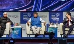 Union Telecom Minister Ravi Shankar Prasad flanked by Telecom Secretary Anshu Prakash (L) and Aditya- India TV Paisa