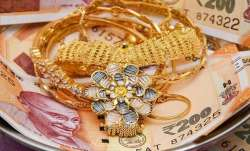 Gold prices up marginally by Rs 15- India TV Paisa