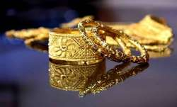 Gold falls marginally, silver rises Rs 52- India TV Paisa