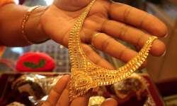 Gold slips by Rs 95 on stronger rupee, weak demand- India TV Paisa