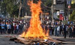 Protestor's burn hoardings and other...- India TV Paisa