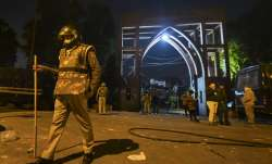 Policemen stand guard near Jamia Millia Islamia...- India TV Paisa