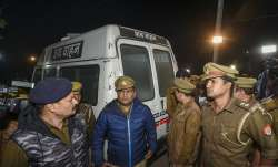 Policemen stand near an ambulance carrying the...- India TV Paisa