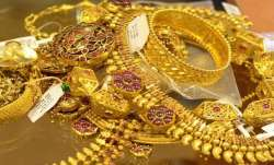 Gold gains Rs 54 on weaker rupee, global cues- India TV Paisa