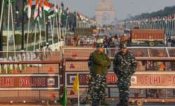 Security personnel stand guard at the...- India TV Paisa