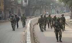 Security personnel patrol streets of Yamuna Vihar area of northeast Delhi- India TV Paisa