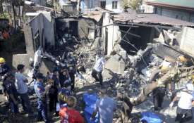 Philippines: 10 dead as small plane slams into house | AP Photo- Khabar IndiaTV