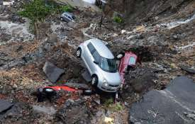 Mumbai Rains: Cars buried as wall collapses after heavy rain, trains services disrupted | PTI- Khabar IndiaTV