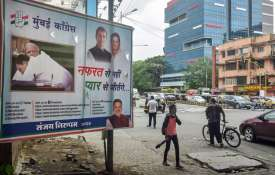 A hoarding with a picture of Congress...- Khabar IndiaTV