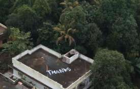 A 'Thanks' note painted on the roof of a house in...- Khabar IndiaTV