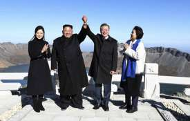 Kim Jong Un, Moon Jae-in join hands on peak of sacred North Korean volcano | AP- India TV