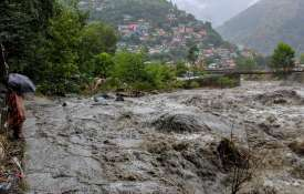 A swollen Beas river flows after heavy rains in...- India TV