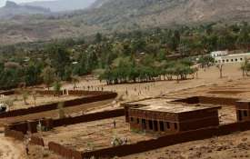<p>20 dead as hill collapses on...- India TV
