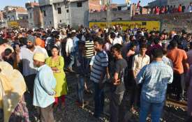local people gather at the scene of the accident along...- India TV