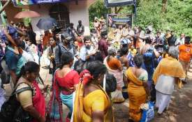 Devotees, including women, outside the Lord Ayyappa...- India TV