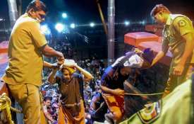 Elderly devotees being assisted by the police to...- India TV Paisa