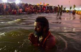 A Sadhu takes a holy dip at Sangam on the...- India TV