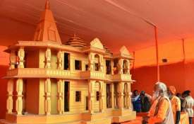 People look at a model of Ram Mandir, to be built...- India TV