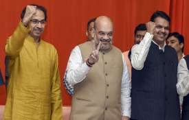Shah-Thackeray seal the deal; BJP to fight...- India TV