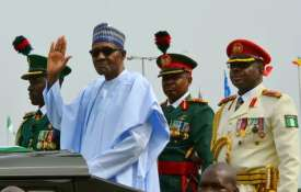 Many dead in stampede at political rally of President Muhammadu Buhari in east Nigeria   AP File- India TV