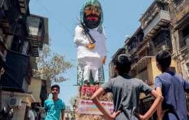 Holi bonfire: Effigies of Masood Azhar, Hafiz Saeed put...- India TV