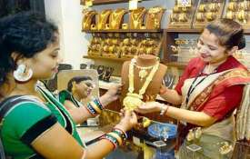 Gold prices rise by Rs 70 on jewellers' buying- India TV