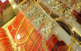 Gold slides by Rs 160 on muted demand, weak global trend- India TV