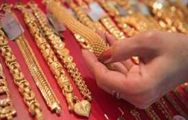 Gold slides on tepid demand, weak overseas trend- India TV