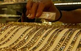 Gold prices fall on muted demand from jewellers; silver firms up- India TV