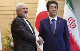 Iranian Foreign Minister Mohammad Javad Zarif and Japanese Prime Minister Shinzo Abe shake hands - India TV