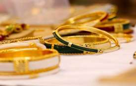 Gold surges Rs 300 on fresh buying, strong global trend- India TV
