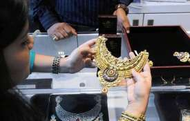 Gold edges up by Rs 100, silver rises Rs 130- India TV