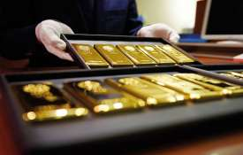 Gold prices fall by Rs 100 on easing demand- India TV