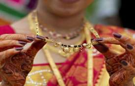 Gold plunges Rs 300 on weak global cues, muted demand- India TV