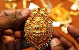 Gold falls Rs 100 on subdued jewellers' buying- India TV