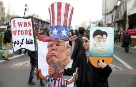 An Iranian woman holds an effigy of US president Donald Trump | AP File- India TV