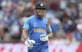 India's MS Dhoni reacts as he leaves the field...- India TV