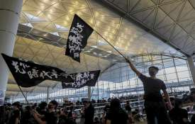 Hong Kong airport shuts down amid pro-democracy protest- India TV