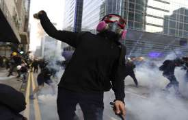 Hong Kong police fire tear gas in renewed clash...- India TV